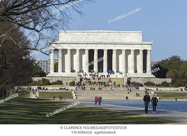 People visit the Lincoln Memorial on a spring day in Washington, DC