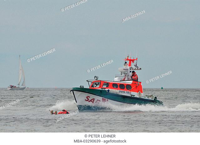Germany, the North Sea, sea rescue, exercise, Ship's boat, sailor, survival suit, distress signal, over the ship's rail