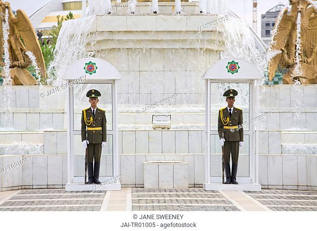 Turkmenistan, Ashgabat, Ashkhabad, Berzengi, Independance Park, Soldiers guarding Gold statue of Turmenbashi - President Niyazov