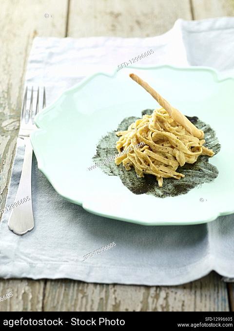 Spelt pasta with whitefish cream on sepia sauce