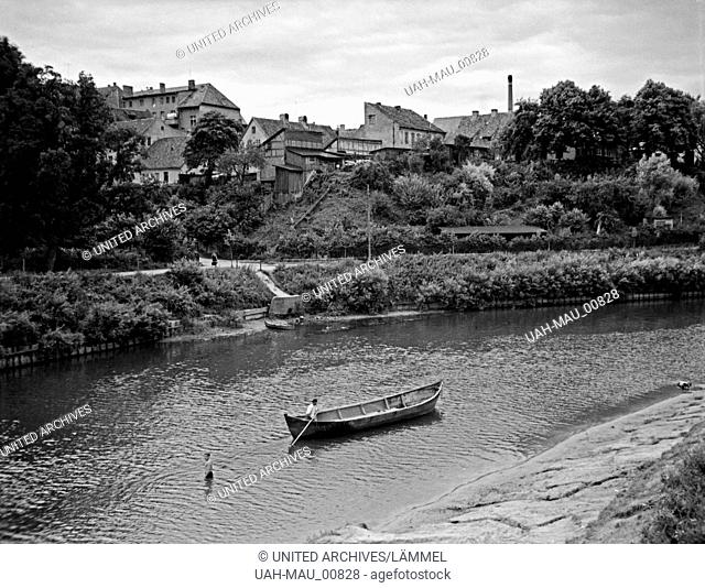 An und in der Inster in Insterburg in Ostpreußen, 1930er Jahre. At the river Inster flowing through Insterburg, East Prussia, 1930s