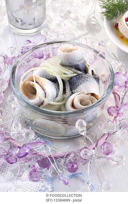 Rollmops (pickled herring fillets) with onion for Christmas
