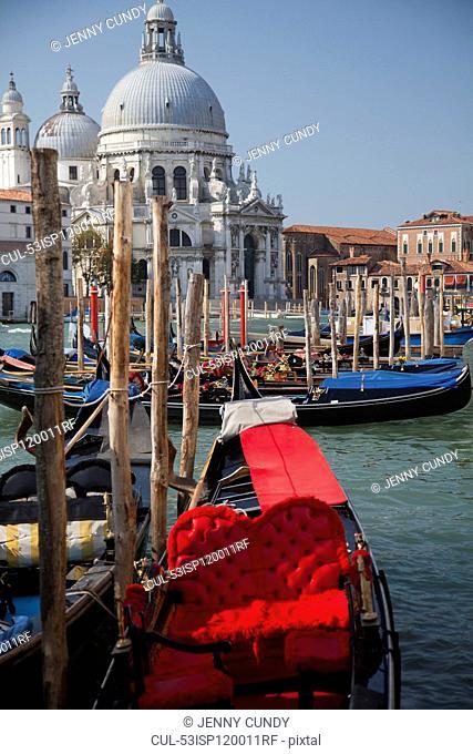 Gondolas docked on Venice canal