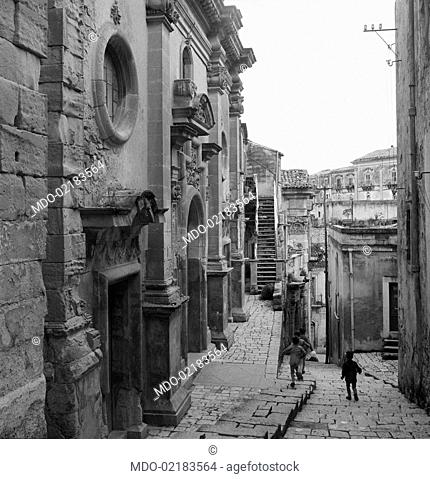 Some children playing in the streets of the neighbourhood called Ragusa Ibla. Ragusa, 1955