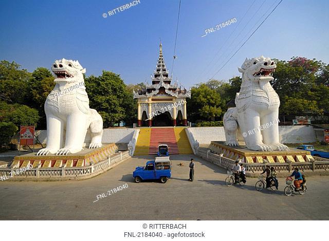 Statues of lion in front of temple, Amarapura, Mandalay, Myanmar