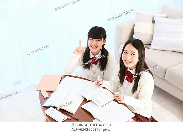 Japanese High-school students in uniform studying together