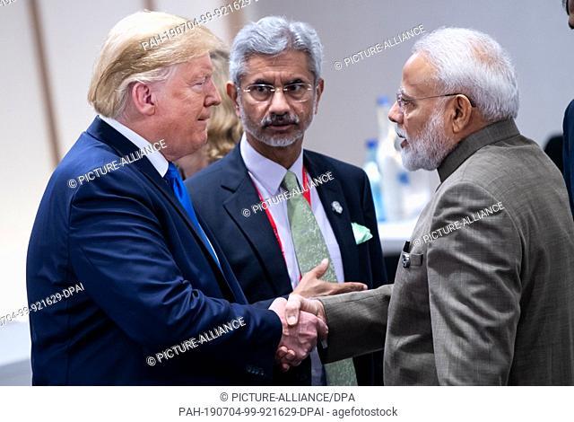 29 June 2019, India, New Delhi: US President Donald Trump and Indian Prime Minister Narendra Modi meet at the G20 summit in Osaka, Japan