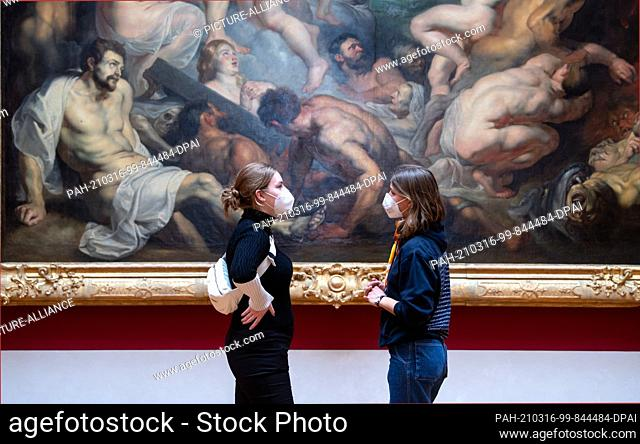 """16 March 2021, Bavaria, Munich: Visitors stand in front of the painting """"""""The Great Last Judgement"""""""" by Peter Paul Rubens (around 1617) in the exhibition at the..."""