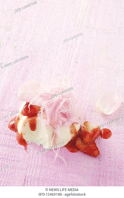 Rosewater panna cotta with strawberries and fairy floss