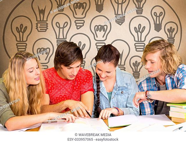 Group of students studying in front of light bulbs graphics