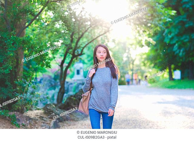Young woman strolling in park