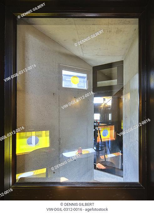 Abstract window view to bar interior. Pálás Cinema, Galway, Ireland. Architect: dePaor, 2017