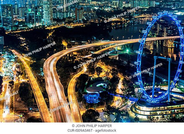 Aerial of highway and The Flyer at night, Singapore