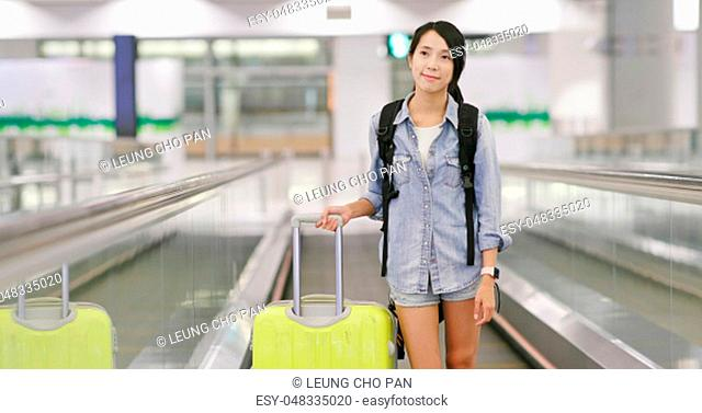 Asian woman traveling in the airport
