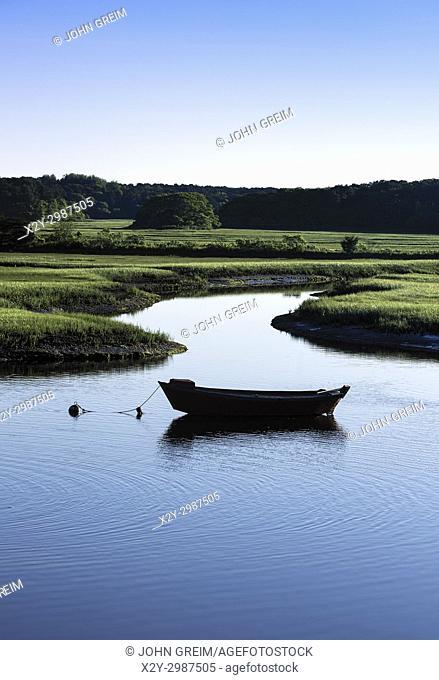 Dory moored in the Herring River, Harwich, Cape Cod, Massachusetts, USA