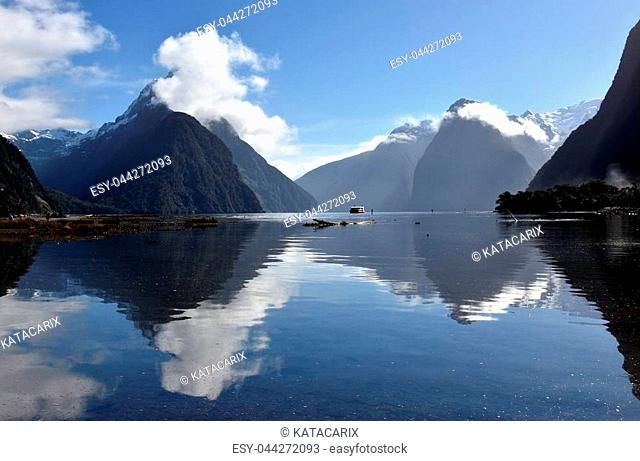 Milford Sound and Mitre Peak in Fiordland New Zealand, water reflection. 8th wonder of the world
