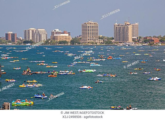 Port Huron, Michigan - Thousands of rafters participated in the annual Port Huron Float Down on the St. Clair River, filling the river between the United States...