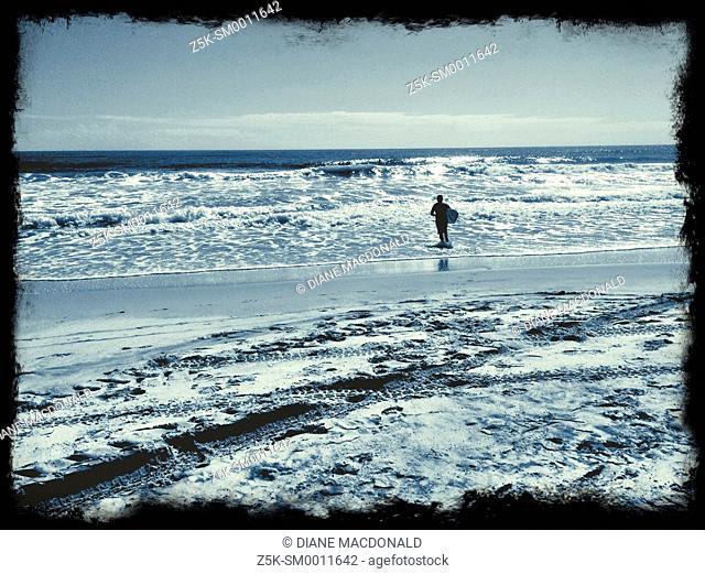 A surfer at Jacksonville Beach, Florida, USA