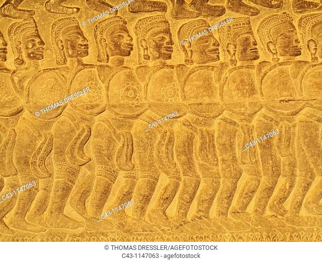 Cambodia - Bas-reliefs of warriors at the east side of the third gallery in the temple of Angkor Wat  The temple complexes of Angkor 'city' were the heart of...