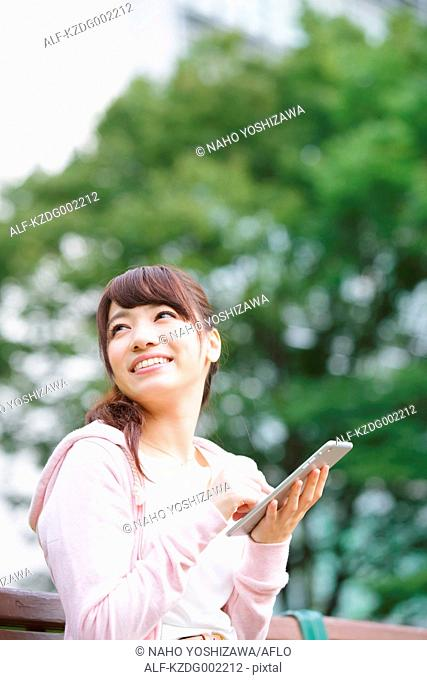 Young attractive Japanese female University student portrait