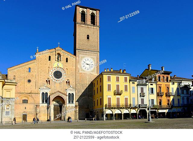 LODI, ITALY: view of the Cathedral of the small town on the square and of the old arcade that surrounds it on a quiet Saturday noon, shot in bright winter light