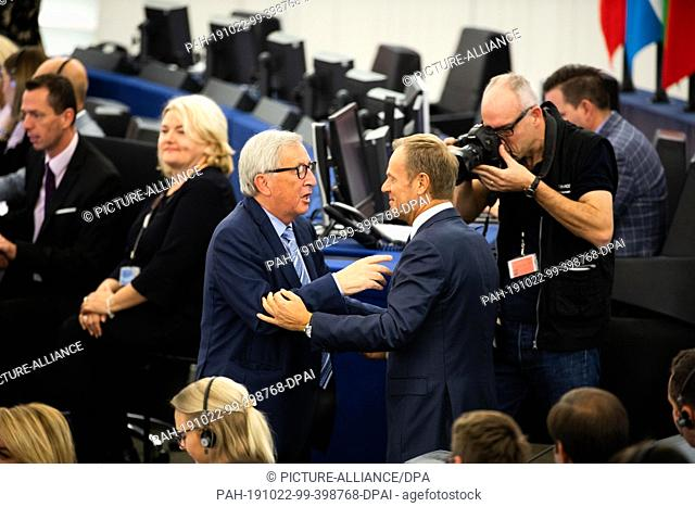 22 October 2019, France (France), Straßburg: The outgoing President of the European Commission, Jean-Claude Juncker (l), is adopted in the European Parliament...