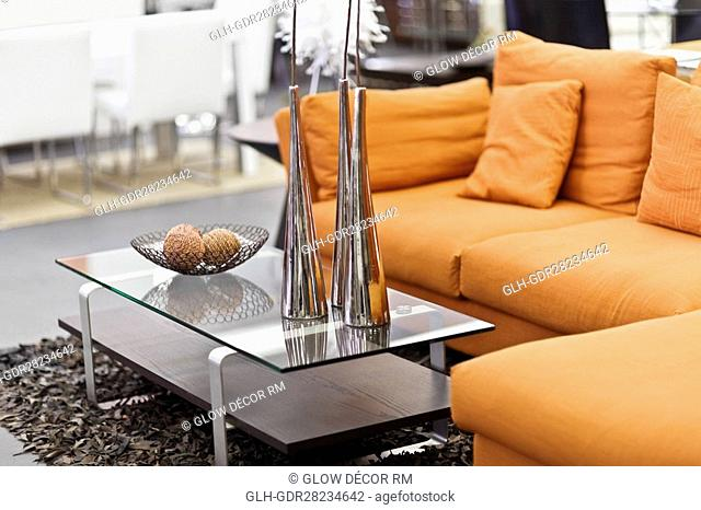 Showpieces on a table with a couch
