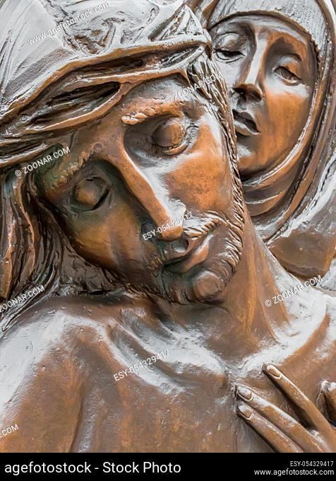 Bronze Statue of dead Jesus Christ down from the cross, being embraced by the Virgin Mary. It can be used for concepts and events