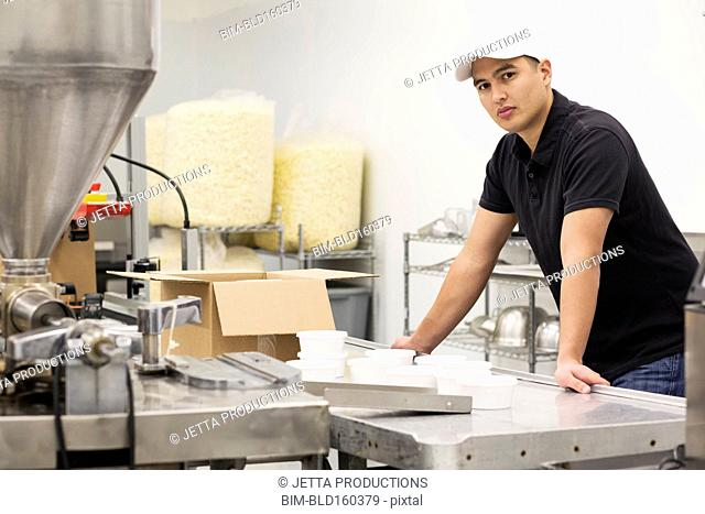 Worker packing product in factory