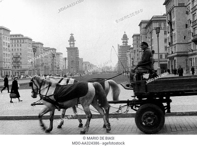 A horse-cart. A Berliner riding a two horses-cart along Stalinallee (now Karl-Marx Allee). East Berlin, March 1956