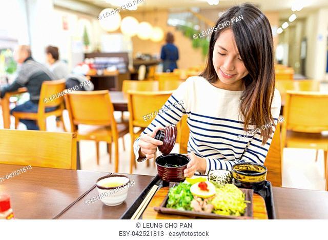 Woman having food in restaurant
