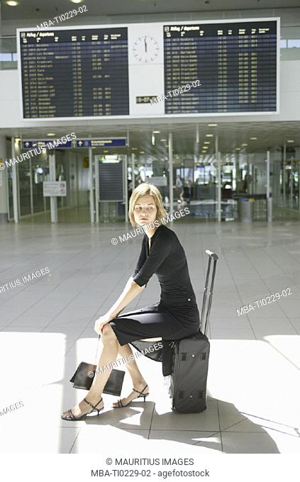 Airport hall, woman, suitcase