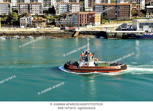 Tug sailing in the port of Pasajes, Donostia, San Sebastian