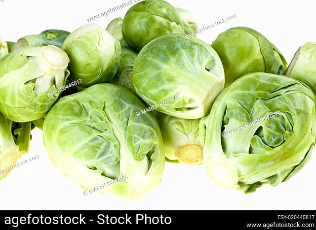 Green brussel sprouts isolated on white background