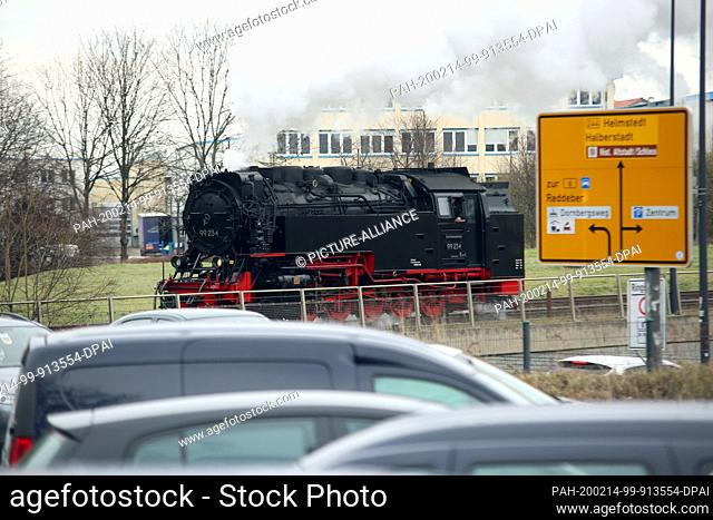 13 February 2020, Saxony-Anhalt, Wernigerode: A steam locomotive of the Harzer Schmalspurbahnen GmbH (HSB) runs on the area of the station Wernigerode