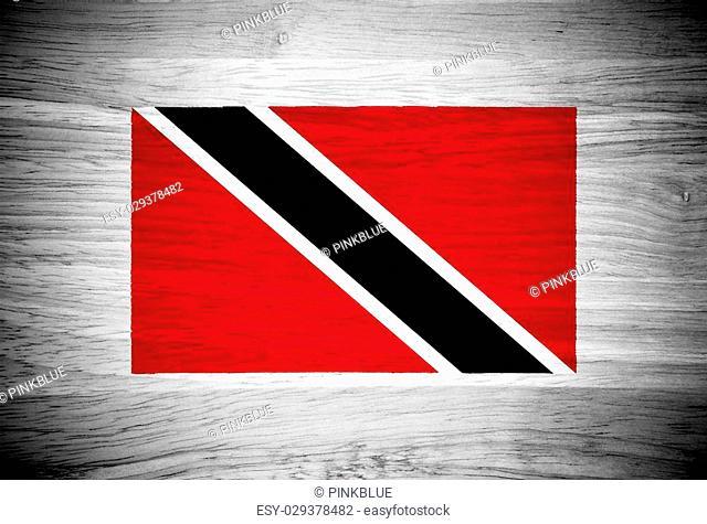 Trinidad and Tobago flag on wood texture