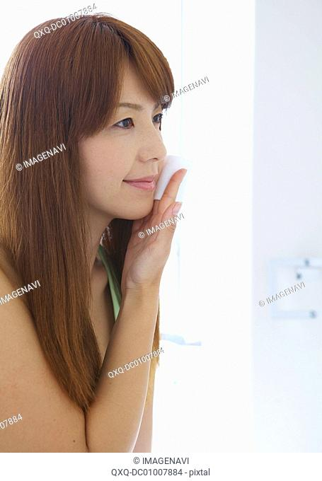 Middle-aged woman taking care of her face