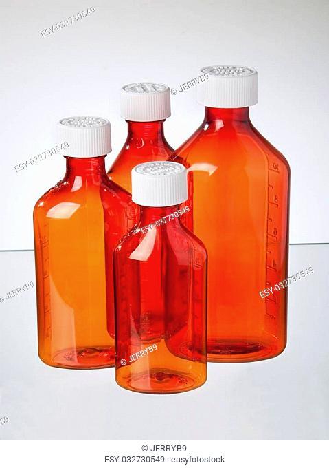 Assorted size medicine bottles for cough meds