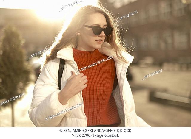 young stylish woman wearing sunglasses, upper body shot, in city Cottbus, Brandenburg, Germany
