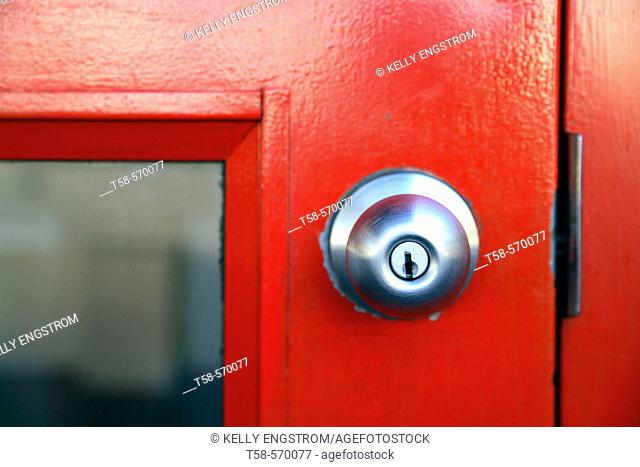 Picture of red door with aluminum knob