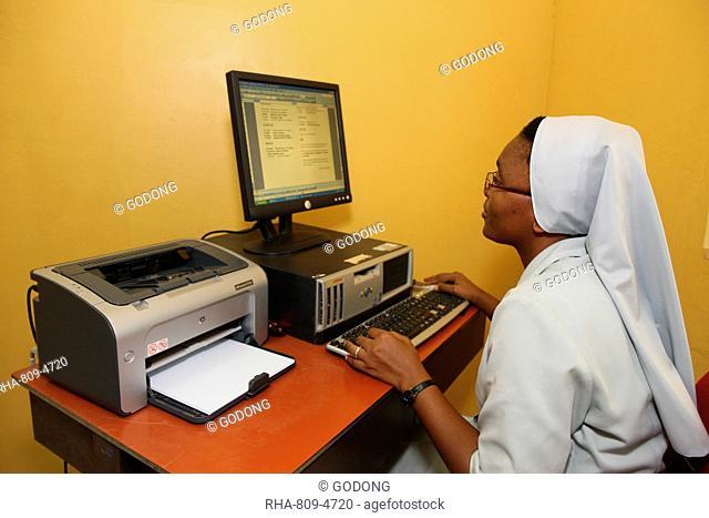 Catholic nun using internet, Lome, Togo, West Africa, Africa