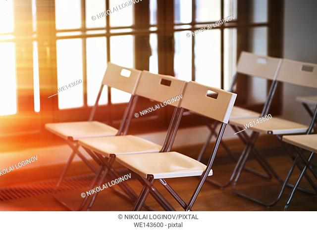 Horizontal office chairs with light leak background