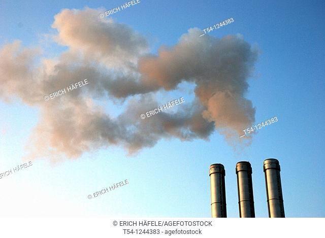 Smoke clouds in the chimney of a heating plant in Wuerzburg
