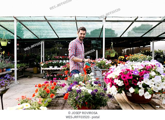 Customer of a garden center looking at plants