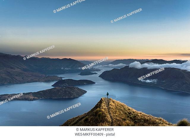 New Zealand, South Island, Wanaka, Otago, Woman on Coromandel peak at sunrise