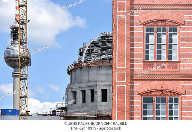 The tower cupola of the new Berlin City Palace currently still under construction (C), which has been named Humboldt-Forum