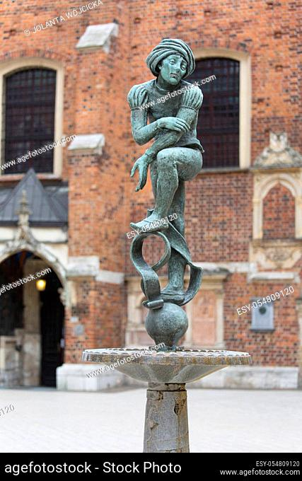 Figurine student, a copy of the form from the altar of Veit Stoss, fountain in the square of St. Mary's, Krakow, Poland