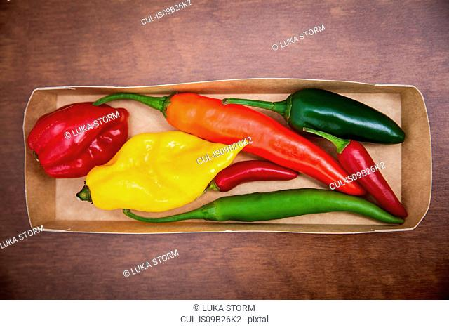Overhead view of various chillies in box