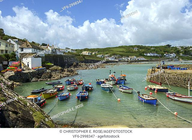 Glorious early summer sunshine on the small boats in the harbour of quaint Coverack village in rural Cornwall, UK