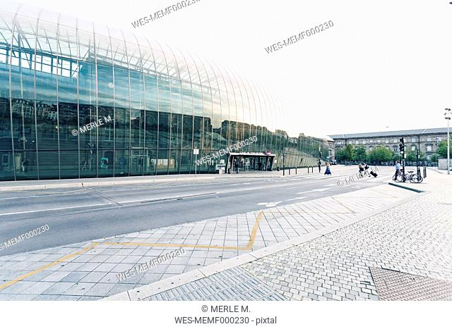 France, Alsace, Strasbourg, new glass facade of main station protecting the old one